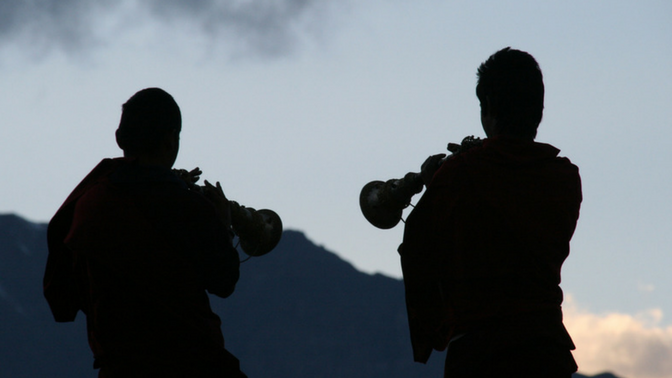 Monks playing trumpets on the Annapurna circuit